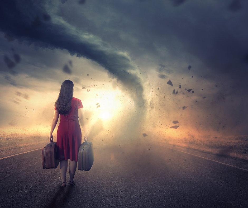 Tornado with woman carrying suitcases.